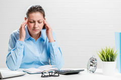 Tired accountant with migraine. In the office portrait royalty free stock photo