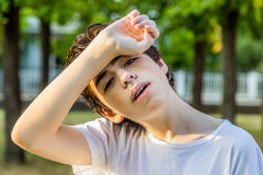Tired Acne teenager with braces Royalty Free Stock Photos