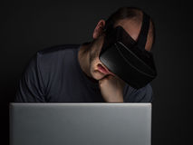 Tired addicted man to technology  using virtual reality headset Royalty Free Stock Photo