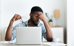 Free Tired African American Employee Having Headache After Working On Laptop Stock Image - 160098361