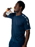 Tired african athlete drinking water Stock Photo