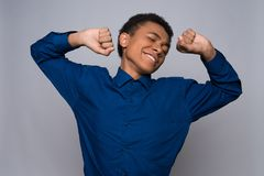 Tired Afro American teenager is stretching oneself Stock Image
