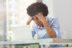 Tired afro man with laptop Royalty Free Stock Image