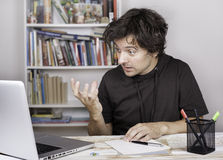 Tired and angry man being overloaded at work Royalty Free Stock Images