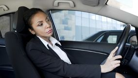 Tired annoyed business woman stuck in traffic jam, late for important meeting stock photography