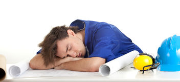 Tired architect with blueprint Stock Images