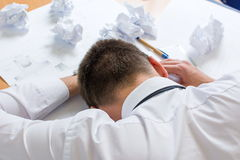 Tired architect sleeping on his project Stock Photography