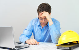 Tired architect. Stock Image