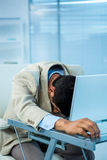Tired asian businessman sleeping. In office Stock Photos