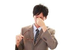 Tired Asian businessman Stock Photos