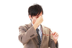 Tired Asian businessman royalty free stock images