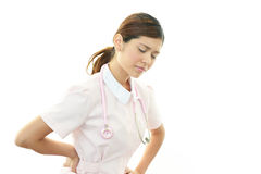 Tired Asian female nurse Royalty Free Stock Images