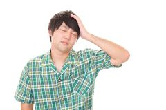 Tired Asian man stock photo