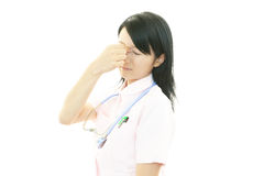 Tired Asian nurse royalty free stock images