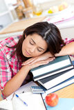 Tired asian student sleeping on her books Stock Photography