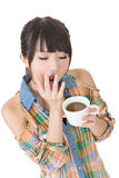 Tired asian woman with cup of coffee Royalty Free Stock Images