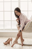 Tired asian woman feeling pain in legs Stock Photography