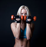 Tired athlete holding weights Stock Images