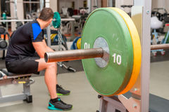 Tired athlete resting on a bench. At the gym stock images