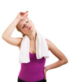 Tired athlete woman. With a towel on a white background royalty free stock image