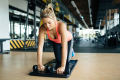 Tired athlete working out. In gym Stock Images