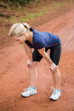 Tired athletic blonde resting Royalty Free Stock Images
