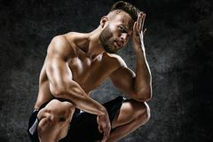 Tired athletic man wiping sweat his hand. Stock Image