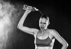 Tired Athletic Woman Pouring Water Over Head stock photos