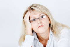 Tired of attractive young blond woman in glasses Royalty Free Stock Photo
