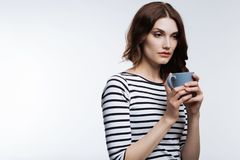 Tired auburn-haired woman drinking coffee Royalty Free Stock Photo