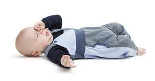 Tired baby on floor isolated on white Stock Photos