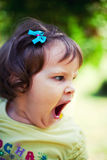 Tired baby girl yawning Royalty Free Stock Images