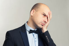 Tired bald man Stock Image
