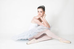 Tired Ballerina. Ballerina resting, sitting down in her costumes stock images