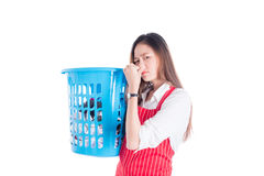 Tired beautiful asian woman holding clothes basket Royalty Free Stock Photography
