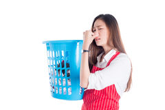 Tired beautiful asian woman holding clothes basket Stock Photography