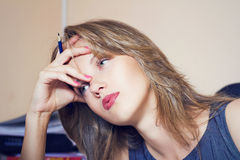 Tired beautiful office woman witn pencil in hand Royalty Free Stock Photography