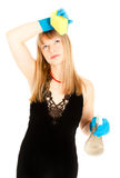 Tired beautiful woman holding sponge Stock Photo