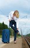 Tired beautiful young lady with suitcase Stock Image
