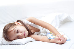 Tired beauty little girl sleeping Royalty Free Stock Photos