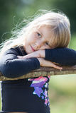 Tired blond hair small girl with clasped hands Royalty Free Stock Photography
