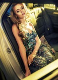 Tired blond lady sitting in the limo Royalty Free Stock Photo