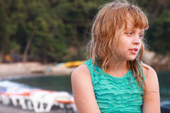 Tired blond little girl on the beach Royalty Free Stock Images