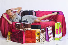 Tired  blonde girl after shopping Stock Photos