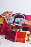 Tired  blonde girl after shopping Royalty Free Stock Photo