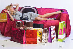 Tired  blonde girl after shopping Royalty Free Stock Image