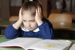 Tired, bored, frustrated and overwhelmed italian first-grader on Royalty Free Stock Photo
