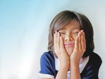 Tired and bored girl. Profile of a nine year old schoolgirl expressing boredom, headache, stubborness, under stress, tiredness, sick, confused, problems, who Stock Image