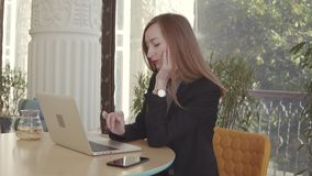 Tired and bored woman is working alone with notebook in office stock footage