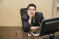 Tired bored young businessman Stock Image